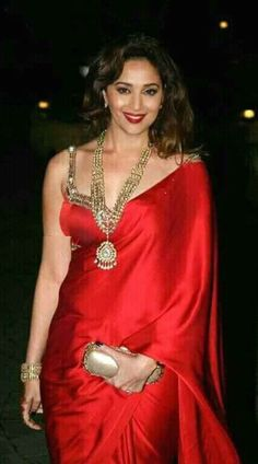 From Trusted Store Red Saree is Sleeveless Blouse Saree worn by Madhuri Dixit with Stone Work Embroidery. Indian Actress Hot Pics, Most Beautiful Indian Actress, Bollywood Saree, Bollywood Fashion, Bollywood Bikini, Indian Dresses, Indian Outfits, Indian Saris, Sari Bluse
