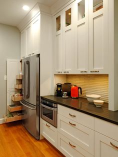 If we can't have a pantry closet, something like this could be nice!  I imagine our pantry and fridge situation will end up very similar to this.