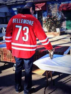 Brett Bellemore makes friends with a kitten during a Thanksgiving turkey distribution in Raleigh. 11.25.13 #canes