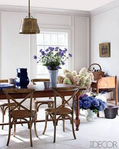 A hanging lamp from Circa Lighting and café-style chairs by Palecek in the breakfast room.