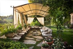 The wooden pergola is a good solution to add beauty to your garden. If you are not ready to spend thousands of dollars for building a cozy pergola then you may devise new strategies of trying out something different so that you can re Pergola Canopy, Outdoor Pergola, Wooden Pergola, Pergola Plans, Diy Pergola, Outdoor Decor, Rustic Pergola, Pergola Shade, Outdoor Rooms