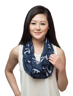 """This Infinite Pi Scarf is made from feather-weight blue polyester for a light and airy feel. Printed with the first 80 digits of Pi, it measures 11 3/4"""" wide x 34"""" long (when doubled over). Since it's an infinity scarf, it has no end, just like Pi."""