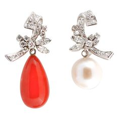 Diamond earrings with interchangeable coral and pearl drops fm Jerome Heidenreich Inc.