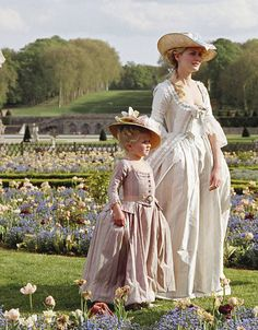 Marie Antoinette film (2006): Kirsten Dunst portraying the titular queen strolling through Versailles with M.A's only surviving daughter Marie Therese