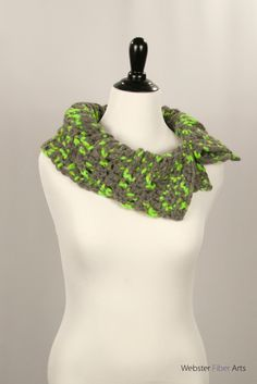 Parakeet Button Cowl by Webster Fiber Arts on Etsy  The versatile Parakeet Button Cowl features a crocheted cable design with a fun neon green and gray yarn. This cowl closes with large black buttons, and can be worn buttoned all the way up, or unbuttoned for a folded down collar. The wool/acrylic blend fibers give a hefty feel to this cowl.