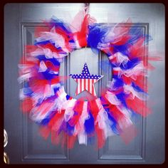 My latest craft project! Tulle 4th of July Wreath. 14 in. Styrofoam wreath. 2 25 yards of each color tulle. Ribbon to hang wreath. Cut tulle 22in. Fold in half and loop and pull through. Use three of each color.  You can add an accent peace in the middle like my star. I hot glued it to the underside of the wreath.