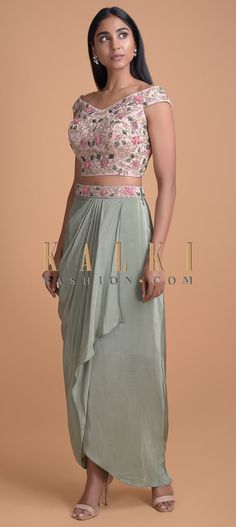 Buy Online from the link below. We ship worldwide (Free Shipping over US$100)  Click Anywhere to Tag Sage Green Skirt With A Cascade Drape And Powder Pink Off Shoulder Crop Top Online - Kalki Fashion Sage green skirt in satin crepe fabric with a fancy cascade drape and pleated details on the waist.Enhanced with cut dana, resham, velvet patchwork and sequins in floral pattern on the waist Off Shoulder Saree Blouse, Off Shoulder Crop Top, Off Shoulder Kurti, Crop Top Designs, Blouse Designs, Latest Indian Fashion Trends, Indian Skirt, Indian Dresses, Crop Tops Online
