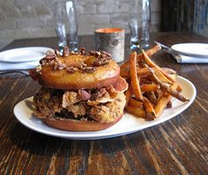 Imagine the three most soul-satisfying foods in one sandwich, and you have Churchkey's take on the Luther Vandross–inspired cholesterol bomb. Buttermilk fried chicken and applewood-smoked bacon stand in for the traditional burger, while a house-made, maple chicken jus–glazed brioche donut studded with pecans is a sweet-savory improvement over the called-for Krispy Kreme.