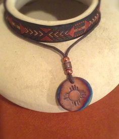 Zuni Sun Symbol Necklace by RavensNezt on Etsy