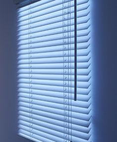 Lighted blinds to hang in dark rooms...awesome idea for a basement!  Make your own by hanging Christmas lights behind blinds, then sheers in front.
