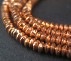 Copper Compessed Bicone Heishi Beads $9.50 for 200. The Bead Chest