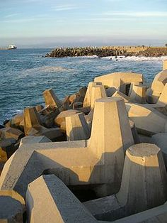 Dolosse, the large concrete structures used internationally to protect harbours, seawalls and coastlines around the world, was invented by South African, Eric Merrifield. Clifton Beach, Port Elizabeth, Out Of Africa, Travel Planner, Rest Of The World, East London, East Coast, Best Funny Pictures, Inventions