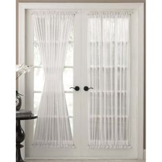 The Reverie Semi-Sheer Door Panel Curtains are available in White o...