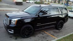 """My 2015 Yukon Denali, with Mirror Ming Paint Protection Shine package, double tint blackout rear privacy glass, 22"""" replica GMC factory black rims on winter blizzak skins, upgraded HID's and Matching LED fog/backup/licence plate lights!"""