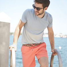 Suit up with a bright pair of swim trunks, your favorite t-shirt and a pair of sunglasses.