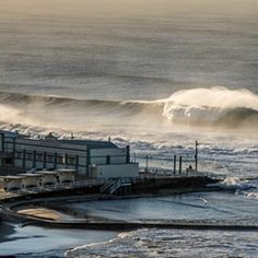 Huge winter swell at Newcastle's famous Merewhether Ocean Baths in NSW