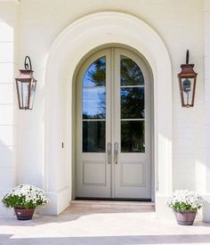 A serene entry with appropriately sized outdoor lamps