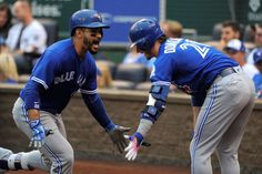 Welcome home:     Devon Travis, left. of the Toronto Blue Jays celebrates his home run with Josh Donaldson in the first inning against the Kansas City Royals in Kansas City, Mo., on Aug. 5