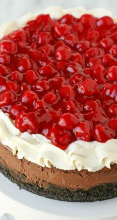 Black Forest Cheesecake Recipe ~ Luscious chocolate cheesecake is topped with whipped cream and cherries to create an impressive and delicious dessert!