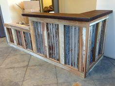 rusty tin repurposed fence | Custom Reclaimed Tin Counter crafted from rusted barn tin.