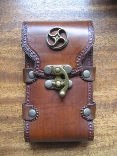 Hey, I found this really awesome Etsy listing at http://www.etsy.com/listing/155128507/steampunk-celtic-iphone-5-sporran-case