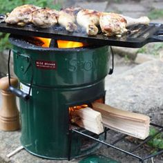 GreenFire Rocket Stove - The perfect stove for the camper. Requires little wood, retains, and produces minimal smoke.  D-10 1/4 in H-10 1/4. Lightweight, insulating, ceramic combustion chamber, cast iron stove top, adjustable galvanized steel pot skirt