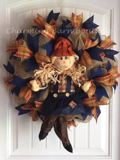 This adorable scarecrow wreath is just too cute and a must have addition for your fall decor. Sassy scarecrow with crossed legs ready to
