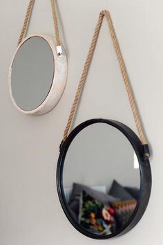 These mirrors are sold separately, but look great as a set too. One is in a soft white washed wood and the other a black metal. They add a funky feature to a wa