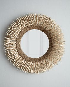 "Round Coconut Shell Mirror --  Beveled mirror w/ handcrafted metal frame embellished w/ coconut-shell sticks & beads -- 30""Dia. x 4.25""D -- 20.24 lbs -- $500 at Horchow"