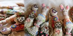 interesting embroidered decorated figures~ they look like fingers from a glove