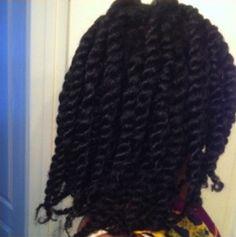 Click the image for Néhémie's natural hair photos and regimen