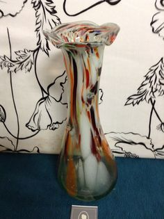 Brown red white and orange art glass vase with flared top