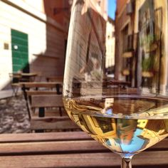 Sipping on a gorgeous Falanghina in a picturesque little square in Reggio Emilia - Instagram by velvetescape