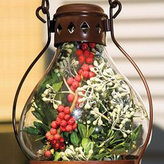 lanterns filled with berries and eucalyptus~ fabulous use of natural elements for Christmas!