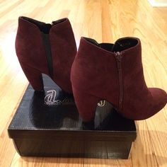 NEVER WORN burgundy booties! Size 6.5 Size 6.5 suede burgundy color booties. Never been worn! Zips up on inner side of shoe. Soles are in perfect condition, since never been worn. No stains or imperfections. Dust bags will come with shoes, but no box. Bought from Charlotte Russe. Smoke free home! Offers and trades are welcome! Charlotte Russe Shoes