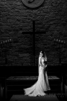 Black and white shot of Kelsey standing in front of the altar in the church for her high fashion bridal session. Jenny DeMarco Photography  www.jennydemarco.com