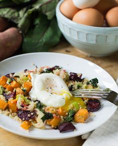 Poached Eggs with Roasted Beet and Sweet Potato Quinoa