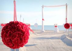 Romantic red pomanders line the aisle