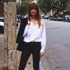 caroline de maigret // collared white button down with double pockets and black skinnies