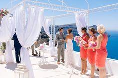 wedding ceremony beautiful bridesmaids in coral dresses gazebo decoration at the Diamond Rock Venue