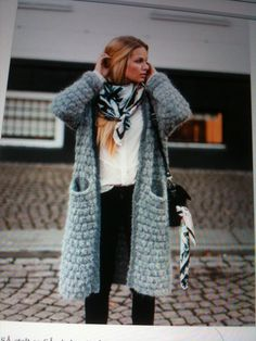 like the styling of the small scarf to draw the eye upwards and act as an opposite to the chunky sweater
