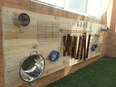 Outdoor musical board using recycle materials and objects for our   children to experiment with sounds and music.....