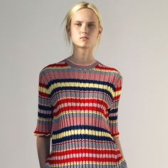 For Celine Resort 2015 Phoebe Philo offers a concise collection of multi-colored stripes, well-vested suiting, luxury t-shirt dressing, cape dressing and high-glam earrings. In other words, prepare to swoon—just as it's hitting stores.