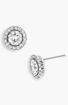 Free shipping and returns on Nadri Round Cubic Zirconia Stud Earrings at Nordstrom.com. Classic studs go from day to night with a rim of sparkling crystal pavé highlighting a cubic zirconia center stone.