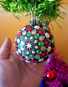 My Mandala Christmas Ball ornaments are hand painted with acrylic and protected with two coats of gloss varnish. Made from plastic which is make them more strong of breaking. The size little bigger than one tennis ball. They are not suitable for outdoor use however. The smooth