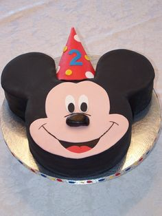 Mickey Mouse Cake - 10 inch head and 6 inch ear cakes covered in fondant.  Hat is a real party hat covered in fondant  Client came earlier than expected and I was finished for literally only 2 minutes before it was picked up!