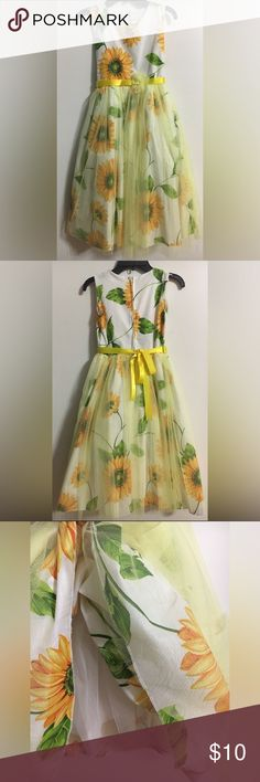 Sunflower Girls Dress 🌻 Size 10 🌻 Perfect summer dress. 🌻 Girls size 10, new without tags. Purchased from Zulily & my daughter never wore it. Dress has sunflower print with yellow ribbon belt and yellow tulle over the skirt. The dress is lined and has more crinoline under the skirt for fullness. Kid Fashion Dresses Casual