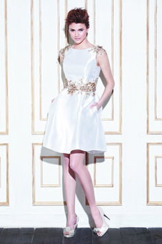 GAGE Bateau neckline knee-length dress in Mikado with gold or silver bead appliqué details at the waist and shoulders, with a peephole back ...