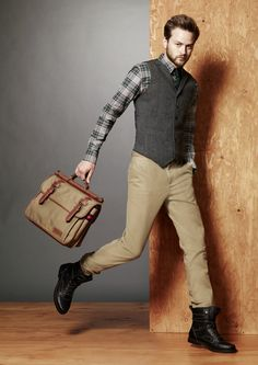 Handsome herringbone vests are the ideal complement to this Fall's newest plaids, by Tommy Hilfiger