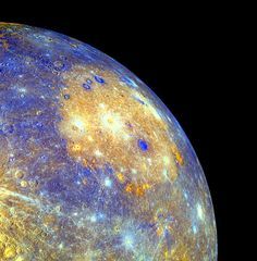 The Caloris basin on the planet Mercury is one of the biggest impact craters in the Solar System. In this colour-coded image by the Messenger probe, the basin is the large yellow patch, pimpled with more recent impact craters, coloured blue. The southern (bottom) rim is surrounded by orange spots, which are lava fields from volcanoes triggered by the impact.(Photo Credit: NASA-JPL)
